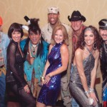 Sue, Trish Morille and Lisa Holthouse hamming it up with The Village People at the 2007 Baylor Gala.